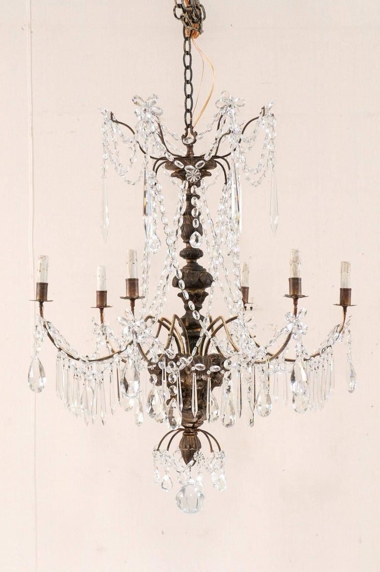 Pair of italian antique six light carved wood and crystal chandeliers