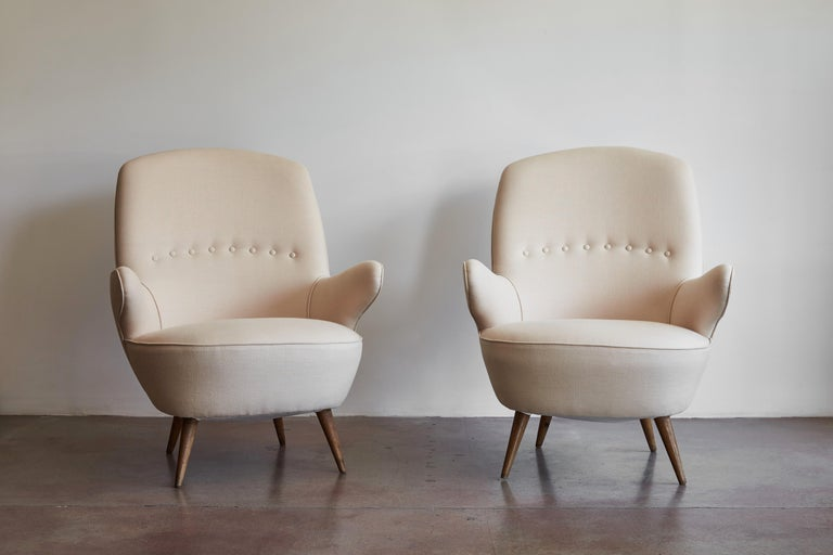 Pair of Italian armchairs newly upholstered in Belgian linen. Made in Italy, circa 1950s.