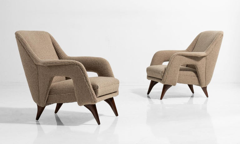 Modern armchairs with wool upholstery tapered wooden legs.
