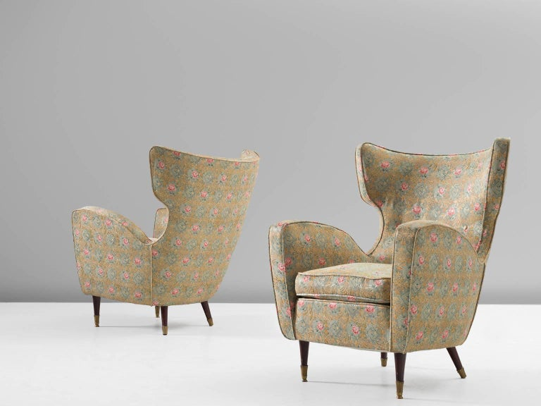 Two lounge chairs, fabric, wood and brass, Italy, 1950s.