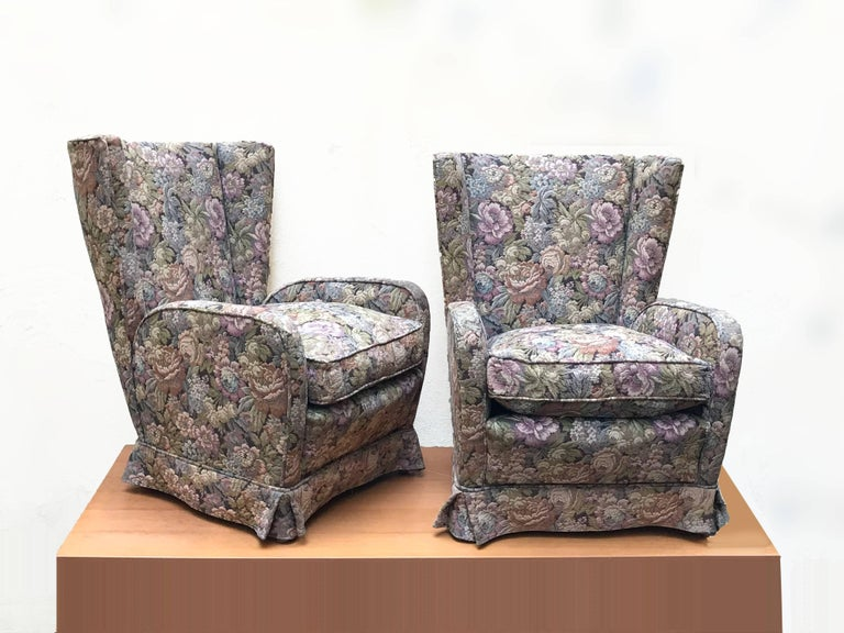 Produced in the 1950s, the armchairs have the original covering of the wooden legs era. These armchairs are in good vintage condition, with normal signs of wear.