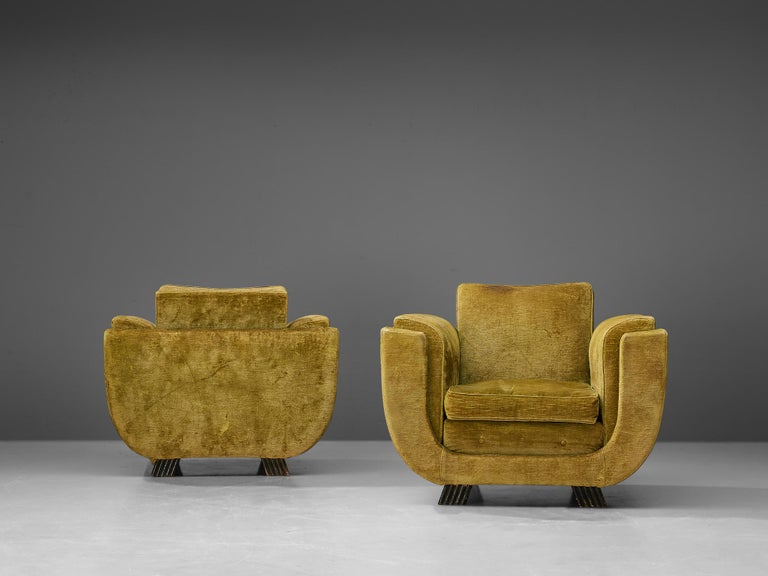 Pair of Art Deco armchairs, velour upholstery, wood, Italy, 1940s  The wide U-shaped frame with low seating and high armrest makes this pair of armchairs really comfortable. The overall velourupholstery includes not only the cushions but the