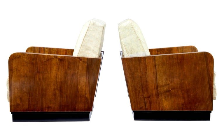 Pair of Italian made deco design armchairs, circa 1953. Beautifully veneered in walnut. Ebonised plinth. Drop in seat and back which is in need of recovering. Minor marks to woodwork.  Measures: Seat height 17