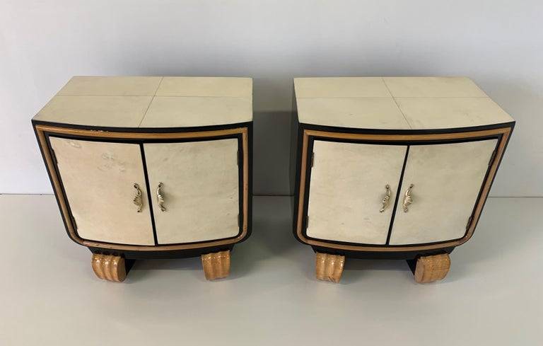 These Art Deco bedside tables were produced in the 1940s in Italy. The front and the top are covered with parchment while the base and the sides are black lacquered. Details are in maple and handles are in brass. Completely restored.