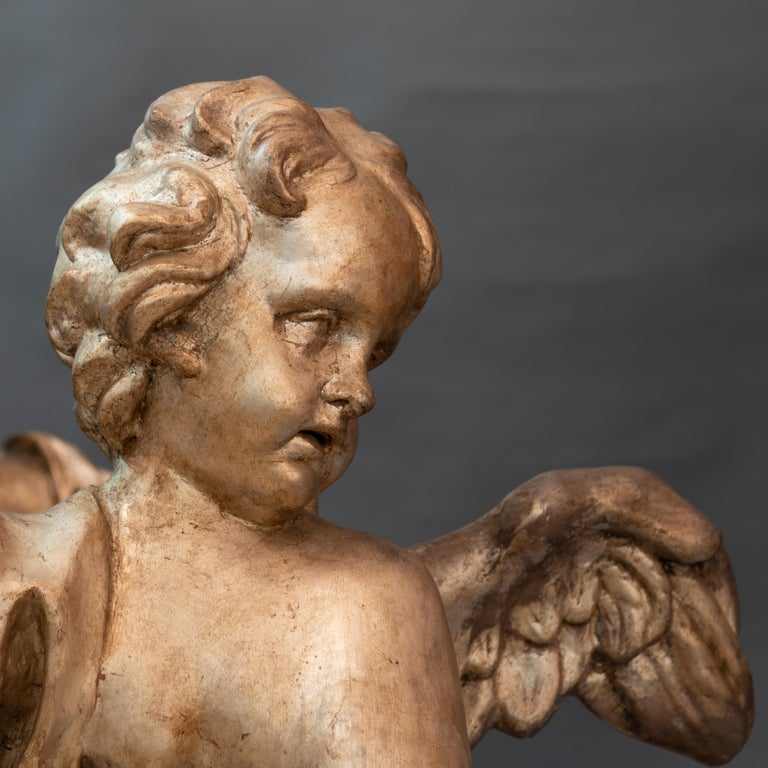 Pair of large angels, mecca silver papier mâché Florence, late Baroque period Original bases in faux marble lacquered wood.  These pair of large angels are shipped from Rome,Italy. Under existing legislation, any artwork in Italy created over 70