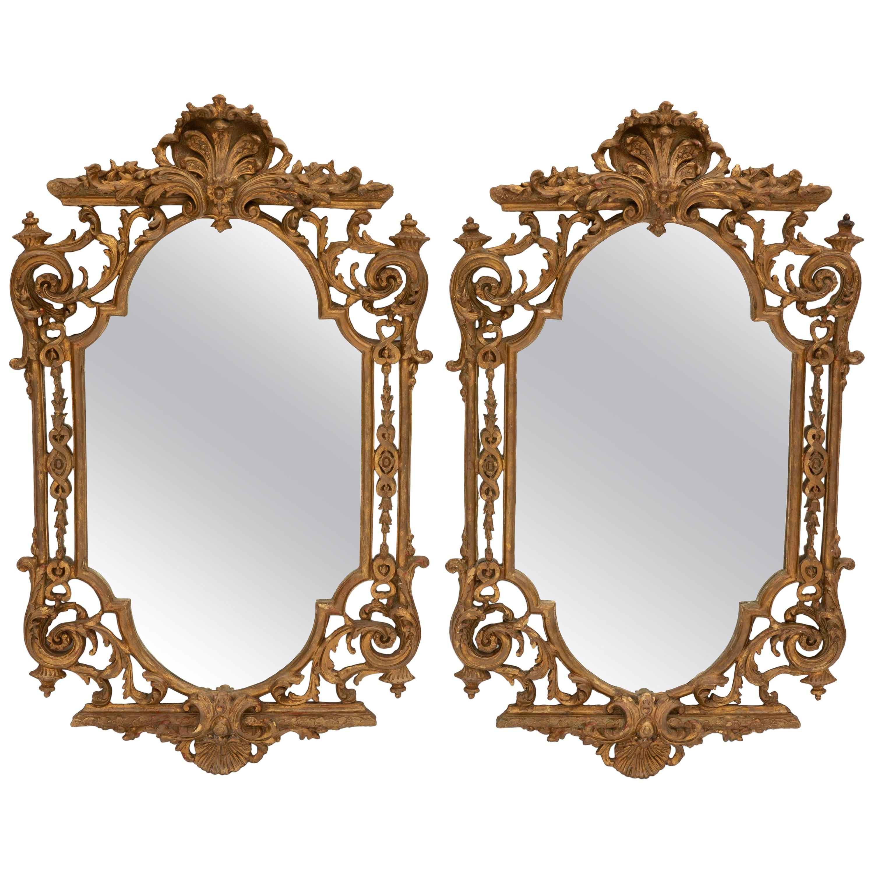 Pair of Italian Baroque Style Carved Giltwood Mirrors