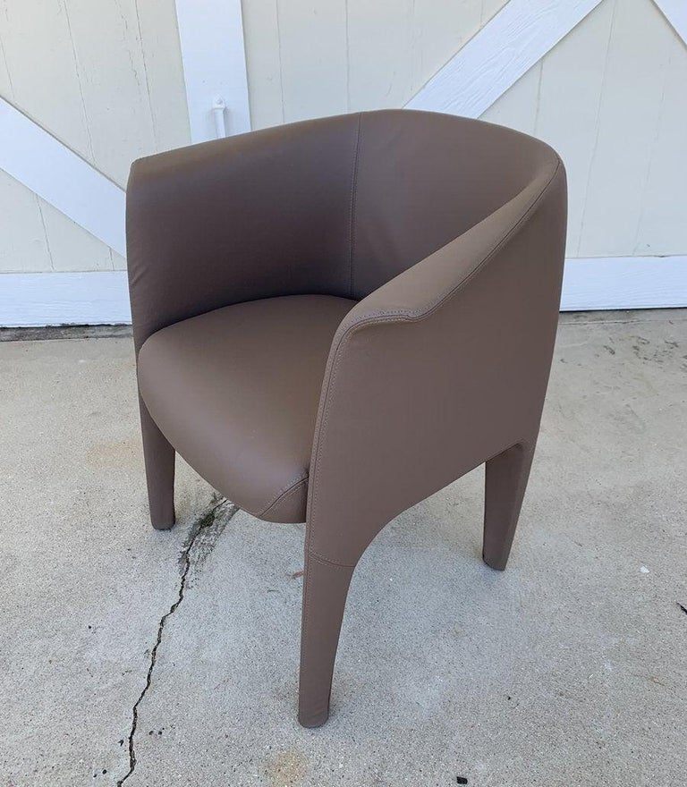 Beautiful armchair designed and manufactured in Italy but no labels are found. Upholstestered in faux Leather. The chairs are in excellent condition.  Measurements: 30.50 inches high x 24 inches deep x 27.75 inches wide x 18 inches seat height.