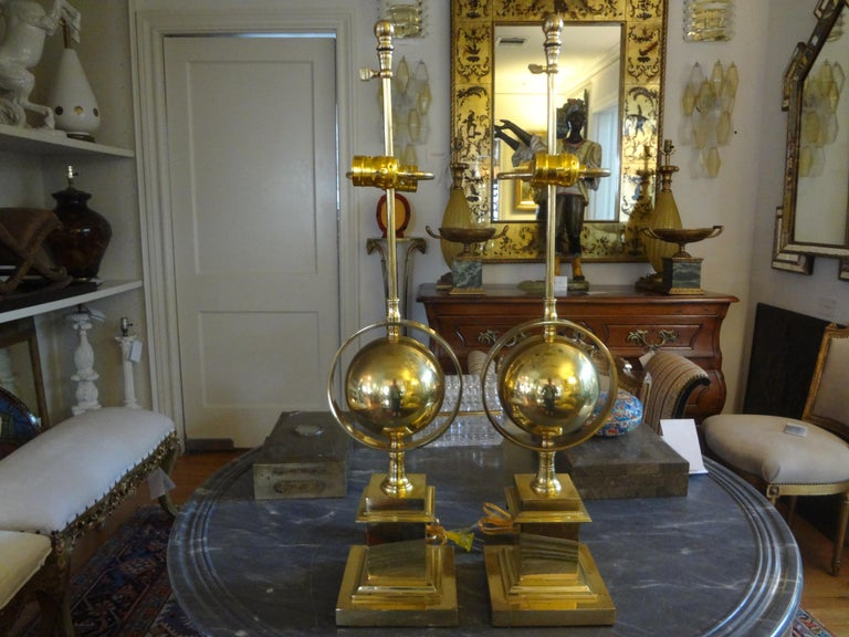 Great pair of midcentury Italian brass armillary lamps. These stunning vintage Hollywood Regency style Italian brass lamps have been newly wired for The U.S. Market with dual sockets and new inline switches.