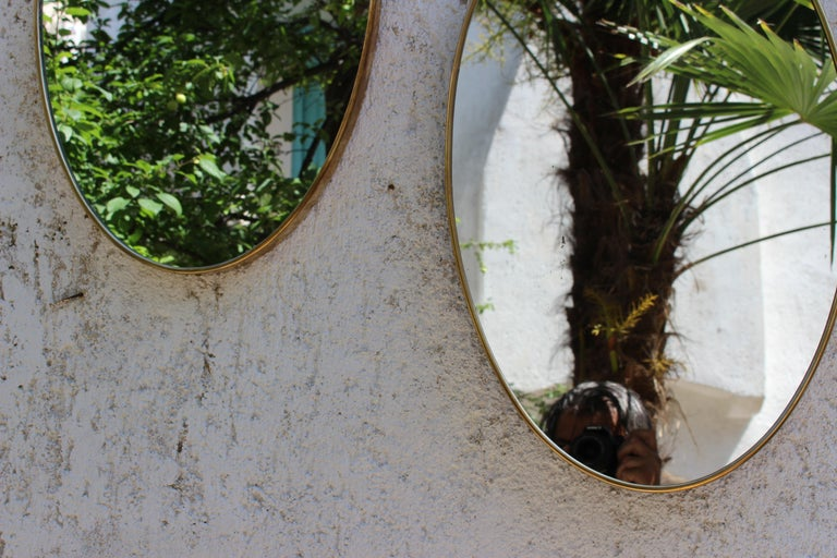 Italian mid century brass mirrors for the wall. Tarnish bras in original condition.