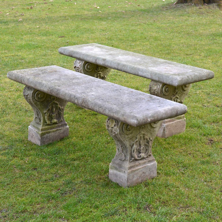 An early, rare pair of carved marble benches from a LI estate, the slab tops raised on supports carved with scrolls, bellflowers, thistle leaf and interlaced vines, Italian, circa 1860. One bench measures 55.5 ins. long, 21.5 ins. high, 18 ins.