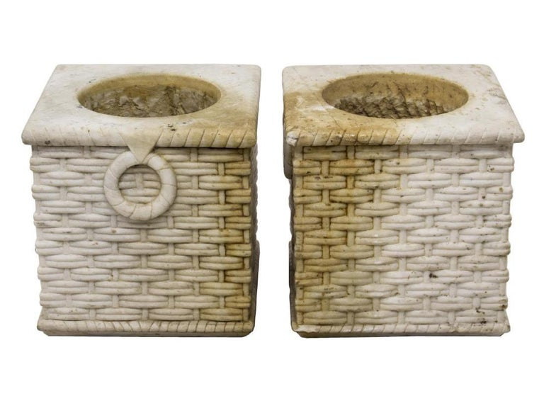 Impressive pair of 19th century Italian neoclassical style finely hand-carved white marble planters in the shape of weaved garden baskets flanked by carved marble ring handles.  Measures: Inside diameter 10