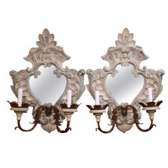 Pair of Italian Carved Painted Oak and Metal Two-Light Mirrored Wall Sconces