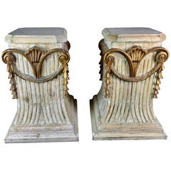 Pair of Italian Carved Painted and Parcel Gilt Pedestals