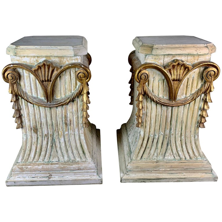 Pair of Italian Carved Painted and Parcel Gilt Pedestals For Sale