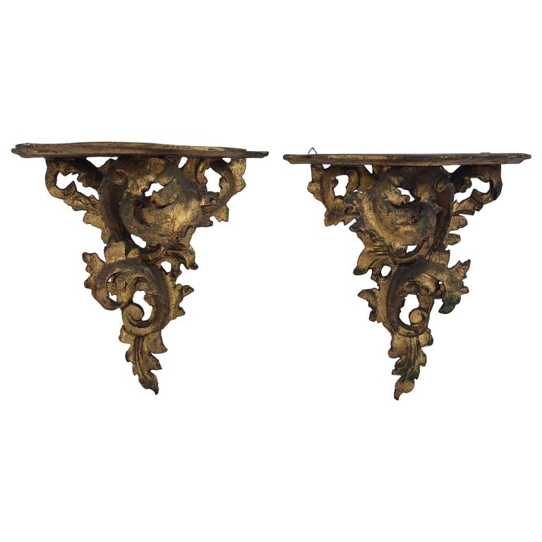 Pair of carved wood Rococo style wall mounted shelves.