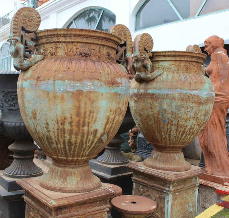 Pair of Italian Cast Iron Urns with Women and Lions Handles In Fair Condition For Sale In Malaga, ES