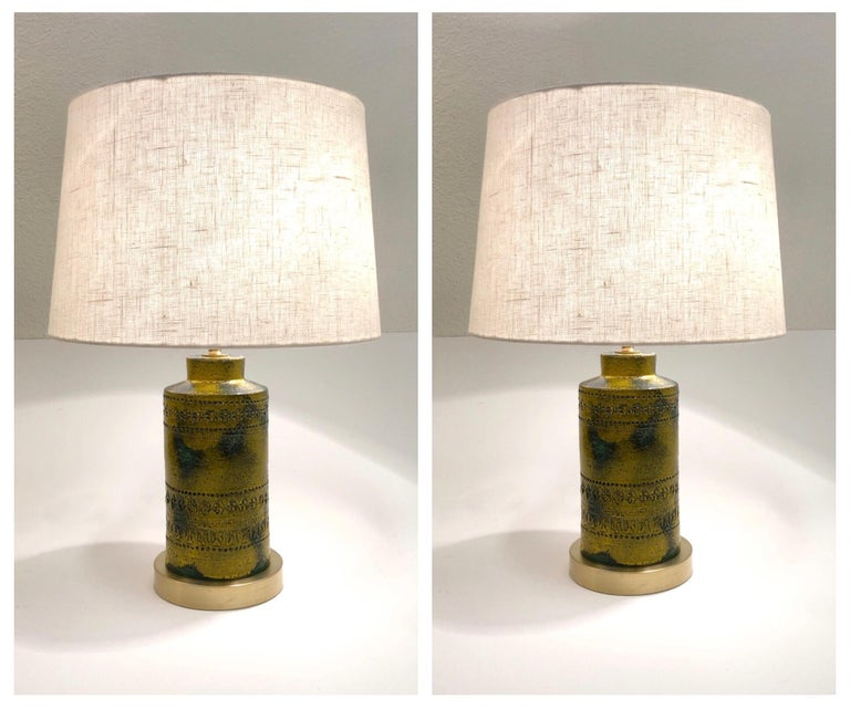 """A beautiful mustard yellow and forests green ceramic table lamps designed by Bitossi in the 1970's.  Newly rewired with all new polish brass hardware, satin brass base and new vanilla linen shade.  Dim: 15 diameter 21.75"""" high."""