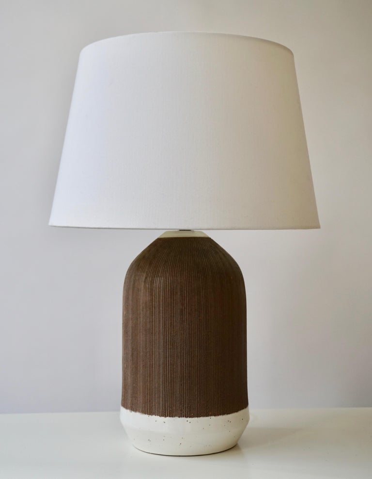 Two circa 1950s Italian white glazed and brown unglazed ceramic table lamps.   Measurements:  Height of body 27 cm - 10.63