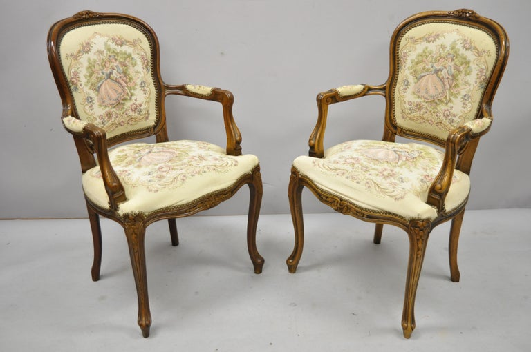 Pair of Italian Chateau d'Ax Spa French Louis XV style Tapestry armchairs. Listing includes solid wood frame, beautiful wood grain, distressed finish, cabriole legs, quality Italian craftsmanship, great style and form, circa late 20th century.