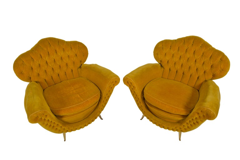 Most elegant and sinuously curved pair of Italian midcentury club chairs. Original button tufted gold colored mohair fabric. On copper legs.