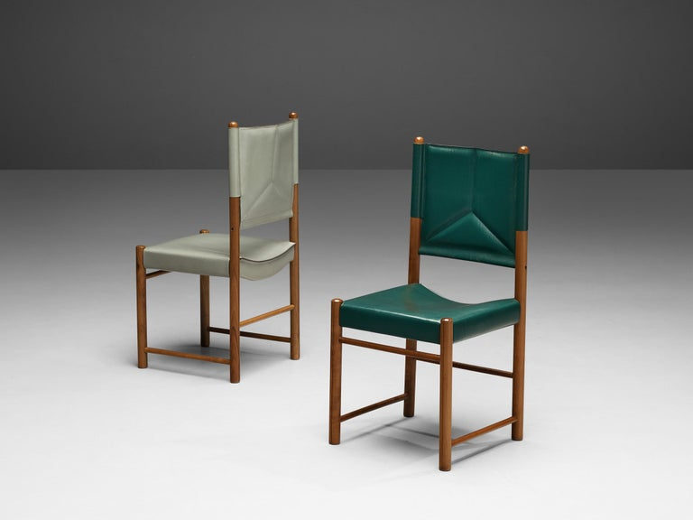 Pair of dining chairs, leather, walnut, Italy, 1980s  This striking pair of dining chairs surprises with a leather in green and grey. Together the leather seats and backrests form an admirable set. The curved seat and the backrest with stitching