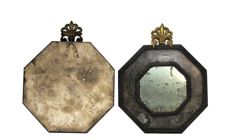 A pair of Wunderkammer mirrors with black fruitwood octagonal shape frames with hard stone covering (Lumachella stone). Gilded brass frieze.
