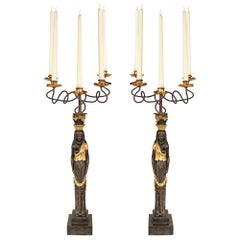 Pair of Italian Ebonized and Giltwood Maiden Five Arm Candelabras