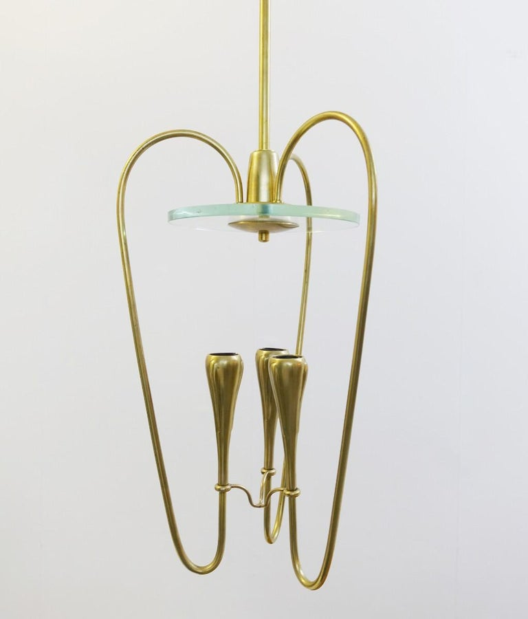 Pair of Italian Fontana Arte style brass and glass pendant light, Italy, 1970s.