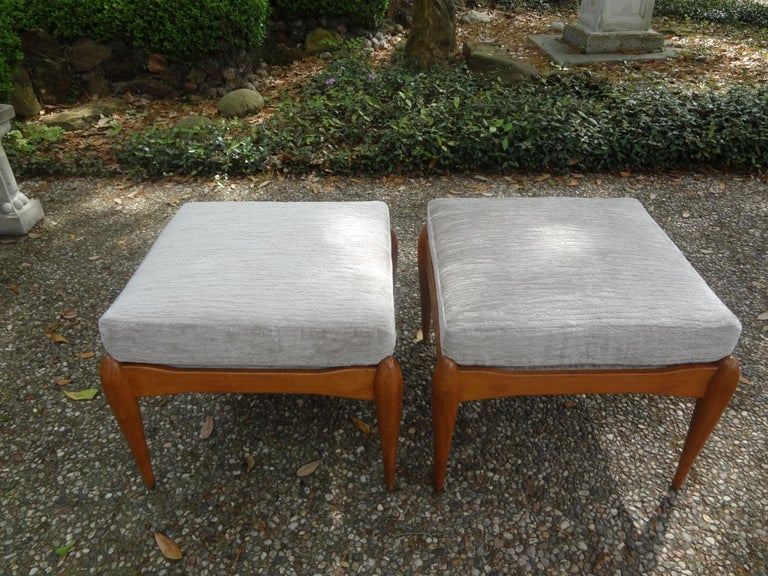 Beautiful matching pair of Italian modern walnut benches or ottomans inspired by Gio Ponti. This stunning pair of Italian stools were taken down to their frames and professionally upholstered with chenille fabric. Our Italian midcentury benches are