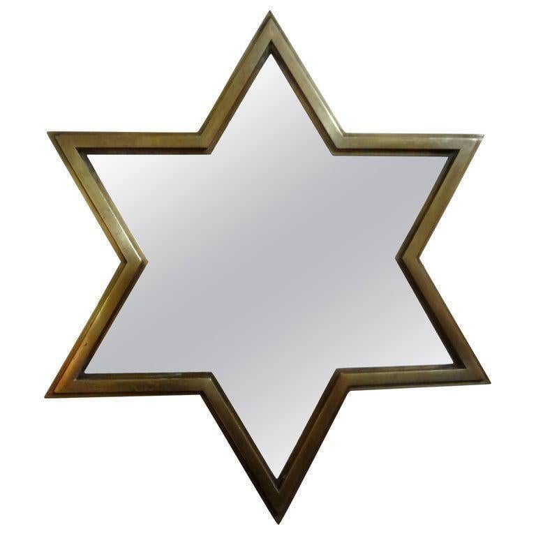 Unusual pair of Italian modern Gio Ponti style star shaped brass mirrors. The depth of these Hollywood Regency Italian brass mirrors give it a 3 dimensional effect. These unique brass mirrors can be used in a variety of decors.
