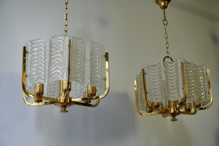 Hollywood Regency Pair of Italian Golden Brass and Murano Glass Pendant Lights For Sale