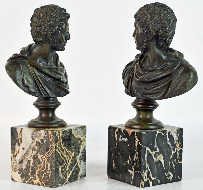 A fine pair of small Italian Grand Tour patinated bronze busts mounted on square marble bases. The two emperors are well detailed and rest on circular shaped socles.