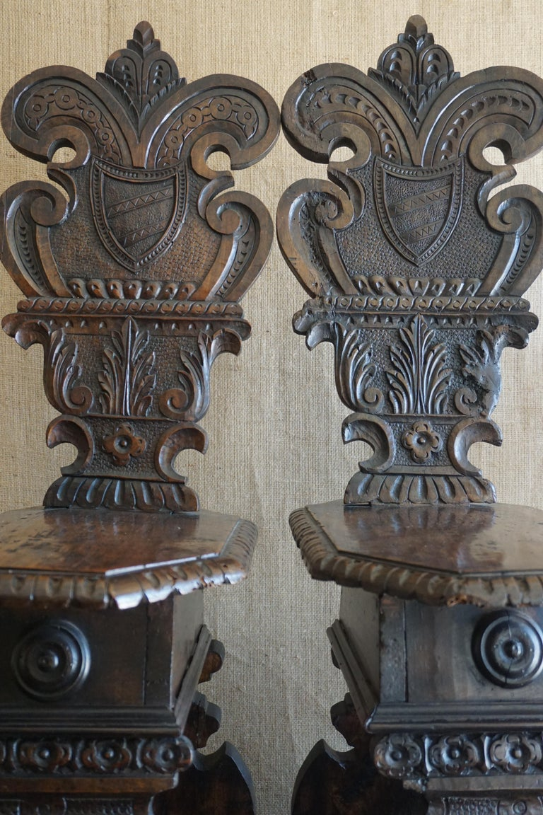 Here we have a lovely pair of hand carved walnut chairs fashioned in the Renaissance Revival style. 