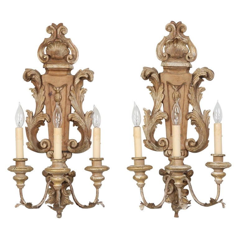 Pair of Italian Hand Carved Wooden Sconces with Gold and Silver Leaf Accents For Sale