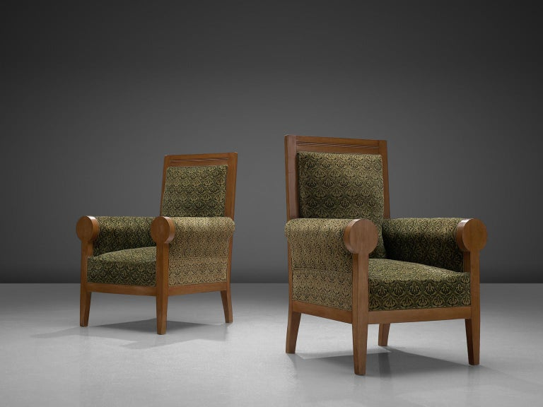 Set of two armchairs, in beech and fabric, Italy, 1950s.  Two stately armchairs in green fabric upholstery. These lounge chairs have a majestic appearance, due their high back and luxurious upholstery. The rounded armrests emphasize this royal