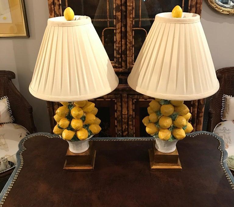 Pair of Italian lemon topiary lamps with shades and matching lemon finials.
