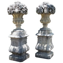 Pair of Italian Limestone Urns with Fruit and Floral Bouquets on Pedestals