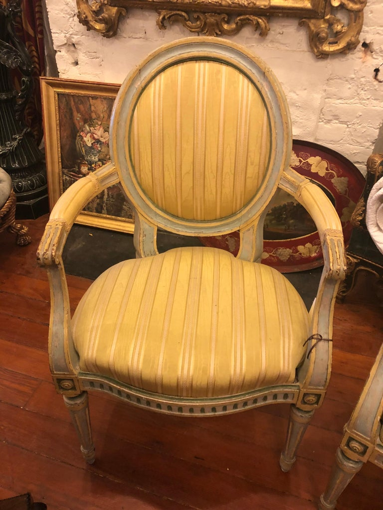 Pair of Italian Louis XVI painted oval Back Fauteuils, late 18th-early 19th century.