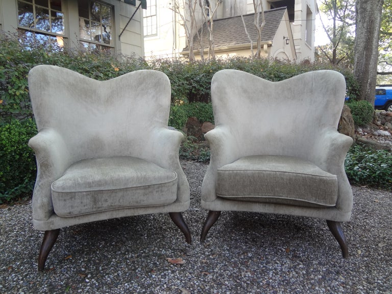 Sculptural pair of midcentury Italian lounge chairs attributed to Paolo Buffa. These stunning Italian lounge chairs or club chairs have an unusual form with beautifully splayed legs. These chairs are both stylish and comfortable. The relatively new