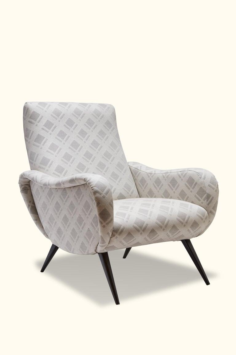 Pair of Italian lounge chairs.