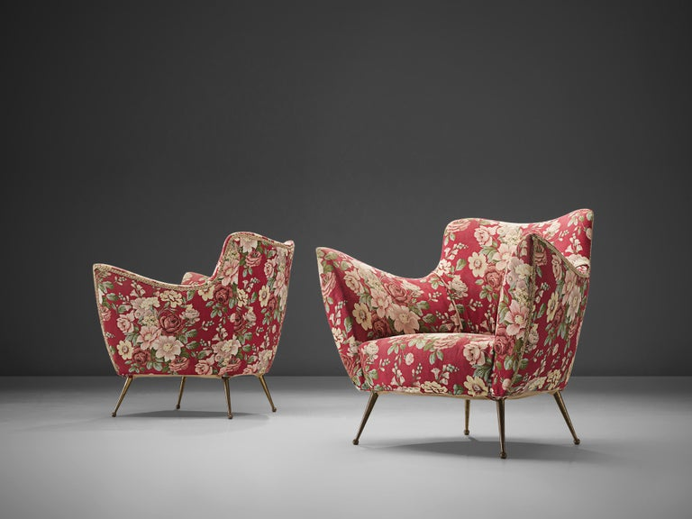 ISA Bergamo, lounge chairs, original floral pink, brass, Italy, 1950s.   These chairs are iconic examples of Italian design from the 1950s. Organic and sculptural, they are anything but minimalistic. Equipped with the original stiletto brass feet