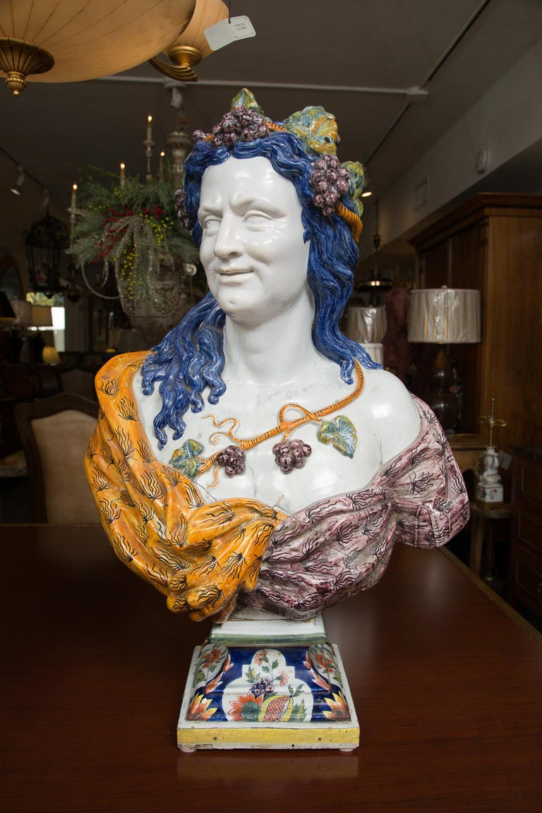 This is a magnificent pair of large Italian Majolica busts on decorative socles depicting a Renaissance couple. Both busts show exquisite sculptural detail expressed in a vibrant combination of sensuous hand painted colors under a glaze, 20th