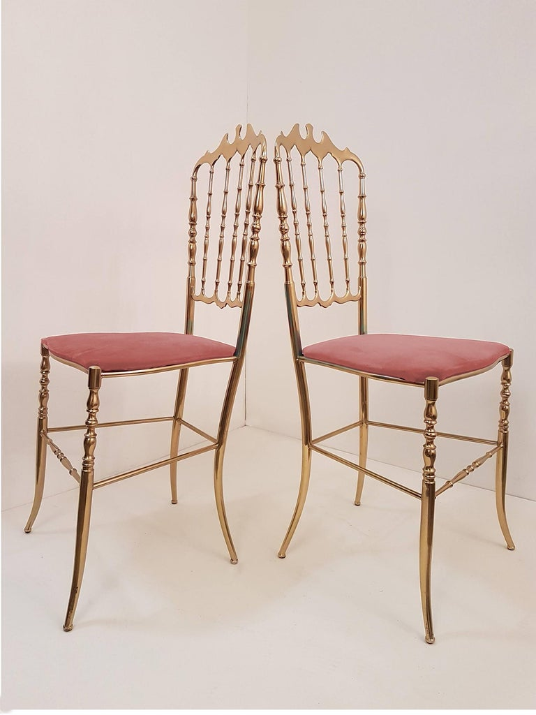 Pair of refined Italian Campanino Classic Chiavari chairs, circa 1950s. Massive brass with upholstered with pink velvet.  In very good condition.