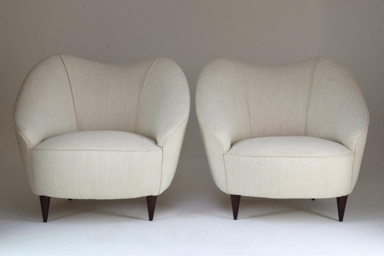 A 20th century vintage set of two armchairs attributed to Italian designer Gio Ponti circa 1950s.      We are an exhibition space and an online destination established by Jonathan Amar Studio. All our pieces are fully restored at our atelier