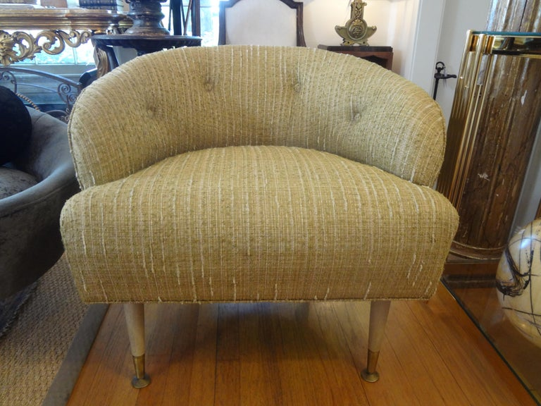 Chic and comfortable pair of Italian Gio Ponti inspired midcentury barrel back lounge chairs. These fabulous Italian lounge chairs, club chairs or side chairs have like beautiful neutral chenille like upholstery with tufted button backs. These