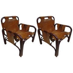 Pair of Italian Mid-Century Modern Rattan and Leather Lounge Chairs by Bonacina