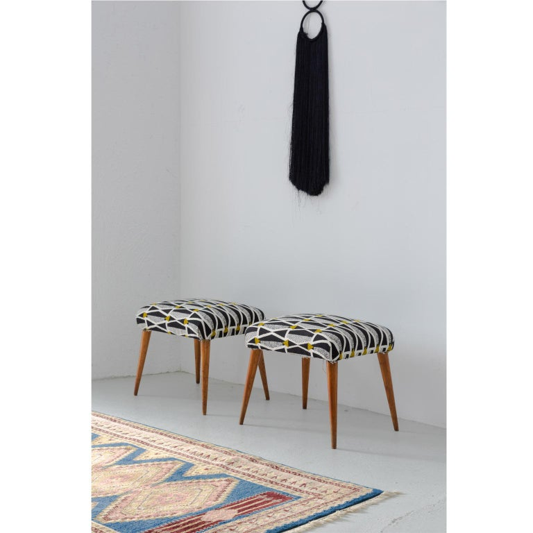 Pair of Italian Mid-Century Modern ottoman lined with new fabric from Gaston y Daniela with a great architectural pattern they can be used in different ways as a decoration, living room, bedroom, side seat the feet are made with wood these two