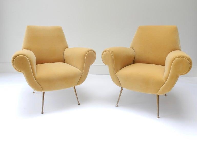 Pair of Mid-Century Modern style armchairs in yellow velvet.