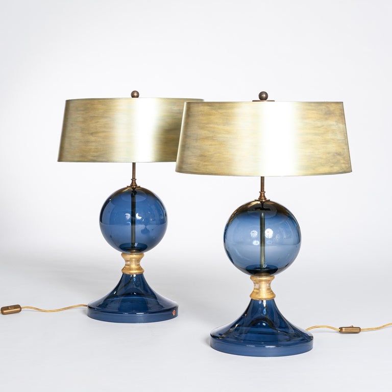 Exceptional Murano glass table lamps in dark blue and gold.  The conical shade is hand painted in several colors.  The shade is gold-colored on the inside, which creates a warm light. Size of the lamp shade: Diameter 40/45cm x Height 18cm Size of