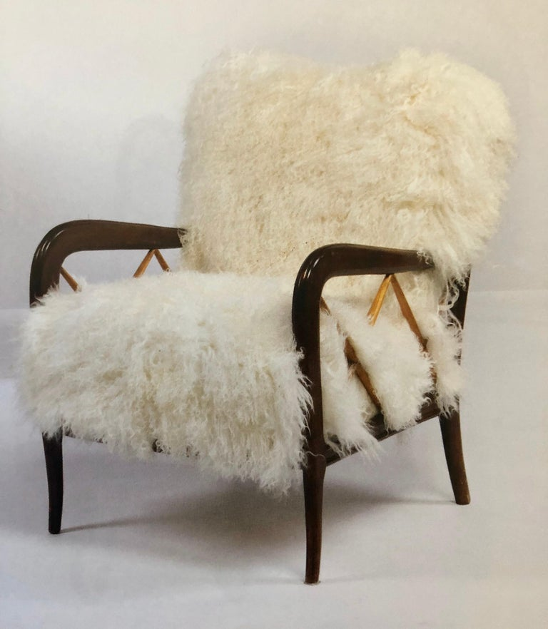 Luxurious pair of Italian Mid-Century Modern neoclassical lounge chairs, armchairs or club chairs circa 1940 by Paolo Buffa (1903-1970). 
